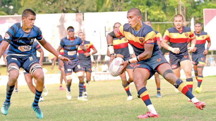 Trinity centre Dilukshan Dange (Ball in hand) trying to make a break from the Thomian defence. Picture by Dushmantha Mayadunne
