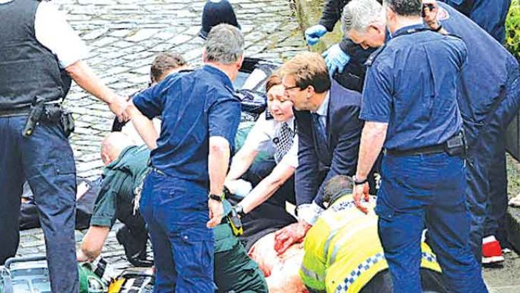 Conservative MP Tobias Ellwood tried to help a wounded police officer, but the officer died at the scene.