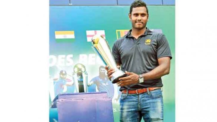 Sri Lanka captain Angelo Mathews displays the ICC Champions trophy at the SLC headquarters yesterday.  Picture by Rukmal Gamage