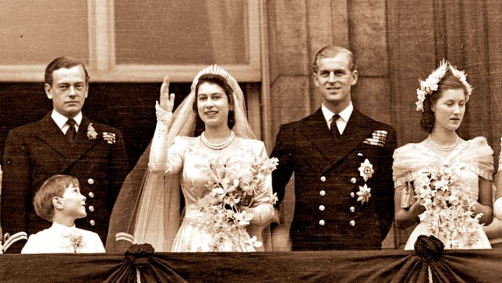 Princess Elizabeth and the Duke of Edinburgh on the balcony of Buckingham Palace, London, waving to the crowd shortly after their wedding at Westminster Abbey on November 20, 1947.