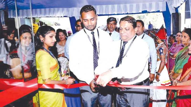 CDB Managing Director and CEO Mahesh Nanayakkara opening the renovated branch at Kotahena