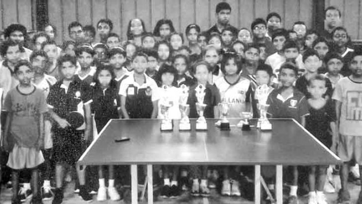 Participants of the coaching camp and tournament with their trophies