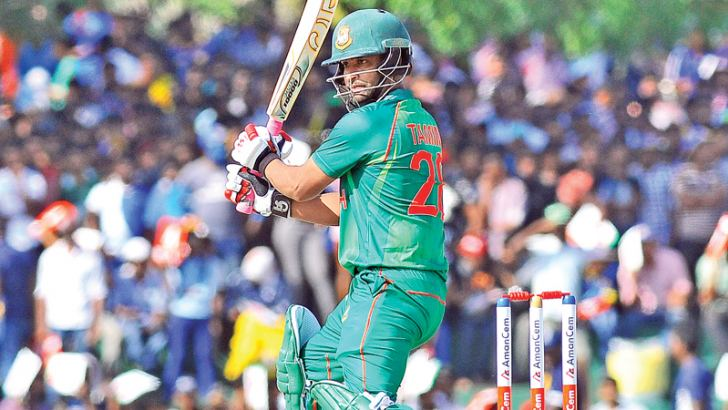 Tamim Iqbal carving out his eighth ODI century at Dambulla, an innings that took him past 10,000 international runs (Tests, ODIs, T20Is) as well.  Pic by Rukmal Gamage