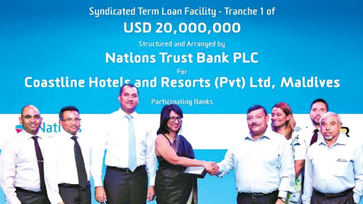 Renuka Fernando, CEO/Director, Nations Trust Bank, Hemantha Gunetilleke, DGM Commercial Banking and Lakshan Wanniarachchi, Manager Project Finance at the conclusion of the transaction with  A U Maniku, Chairman of Coastline Group and other Directors.