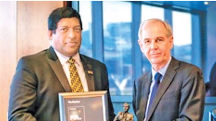 The Banker's Chief Editor Brian Caplen handing over the award to Minister Ravi Karunanayake in London.