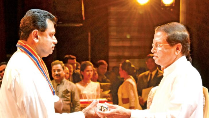 The Group Chairman of LAUGFS Holdings, W.K.H. Wegapitiya receiving the award from President Maithripala Sirisena