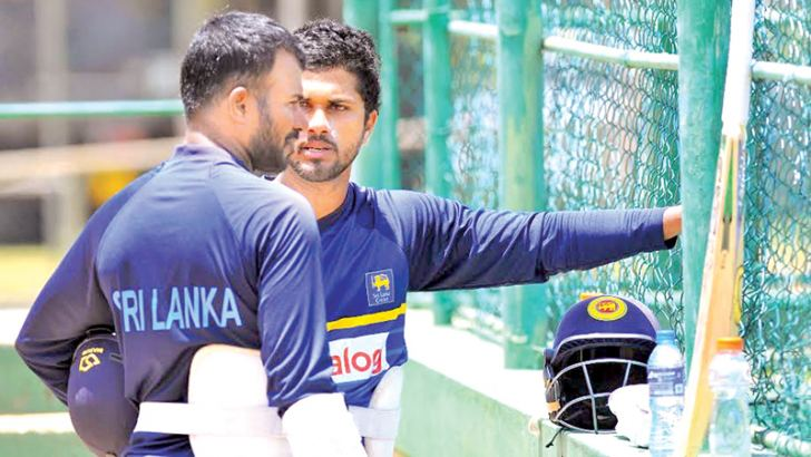 Sri Lanka captain Upul Tharanga and vice-captain Dinesh Chandimal in serious discussion at practice at the Rangiri Dambulla Stadium yesterday ahead of the second ODI against Bangladesh.