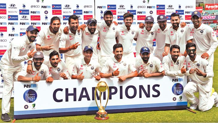 India's cricket team poses with the Border-Gavaskar trophy during the fourth day of the fourth and final cricket Test match between India and Australia at The Himachal Pradesh Cricket Association Stadium in Dharamsala on March 28. AFP