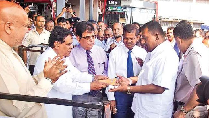 Transport and Civil Aviation Minister Nimal Siripala de Silva handing over the engine documents