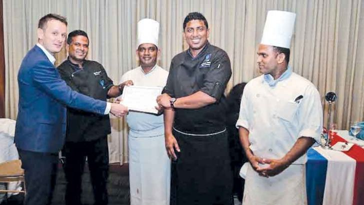 The award winning Water's Edge Culinary Team receiving accolades from Jean-Philippe Gavois