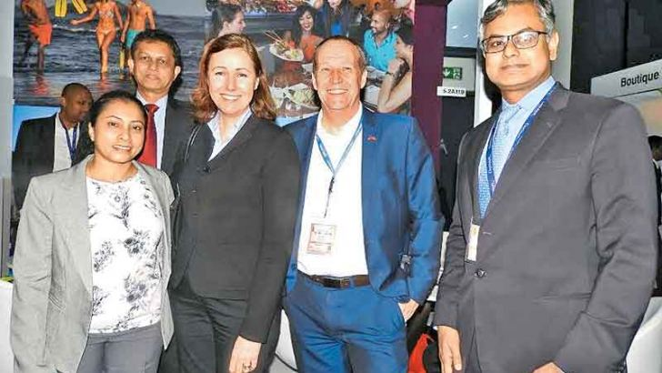 The John Keells and Kouni Travel Agency senior management team at the JKH stall at ITB Berlin.