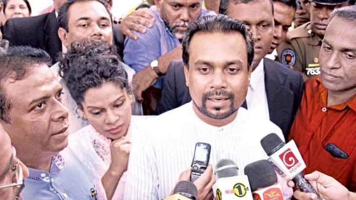 MP Wimal Weerawansa leaving the court premises after been granted bail.