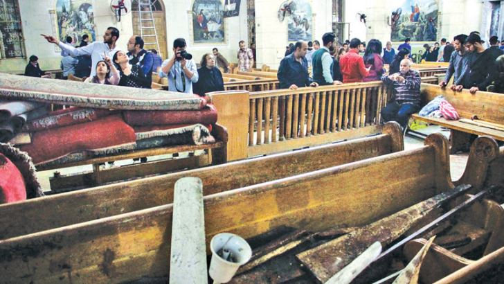 A picture taken on April 9, 2017 shows a general view of the destruction, debris, and blood stains on the benches of the Mar Girgis Coptic Orthodox Church in the Nile Delta City of Tanta, north of Cairo, at which a bomb blast struck worshippers gathering to attend the Palm Sunday mass. - AFP