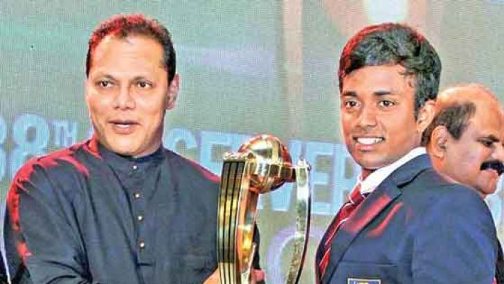 Flashback: Charith Asalanka of Richmond College Galle was adjudged the Schoolboy Cricketer of the year for the second consecutive year at last year's ceremony while his team was adjudged the best team from Southern Province. Here Asalanka receiving the trophy on behalf of his team from Sports Minister Dayasiri Jayasekera.