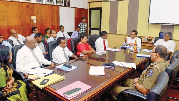 Health Minister Dr. Rajitha Senaratne and Provincial Councils and Local Government Minister Faiszer Musthapha at the discussion on dengue control.