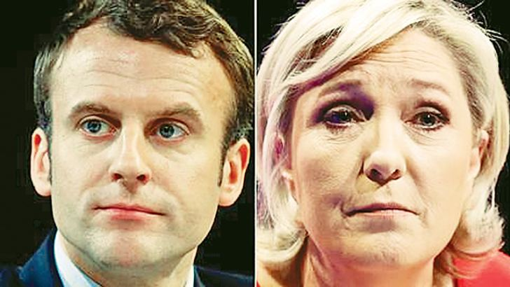 Emmanuel Macron (L) and Marine Le Pen to face off in second round of French Presidential election