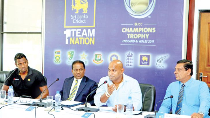 Chairman of selectors Sanath Jayasuriya stresses a point during the press conference held at Sri Lanka Cricket headquarters yesterday to announce the Sri Lanka squad for the ICC Champions Trophy. Skipper Angelo Mathews, SLC president Thilanga Sumathipala and SLC assistant secretary Ravin Wickremaratne are also present. Picture by Saman Sri Wedage