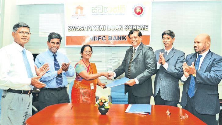 HDFC Bank CEO and GM  Upali Hettiarachchi and Regional Development Director D.V.S Dayawansa exchange the agreement while Deputy Directors U.L.Thilakarathna, B.Lokuranamuga and HDFC Bank Chief Credit Manager Manjula Dissanayaka and Development Credit Manager Anura Dissanayaka look on.
