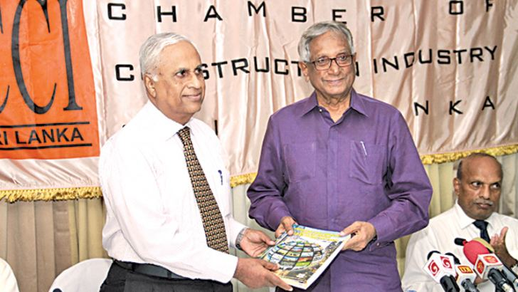 The first copy of the CCI Trade & Business Directory being presented to Chamber of Construction Industry President Dr Surath Wickramasinghe by Secretary General CCI Eng. Nissanka N Wijeratne