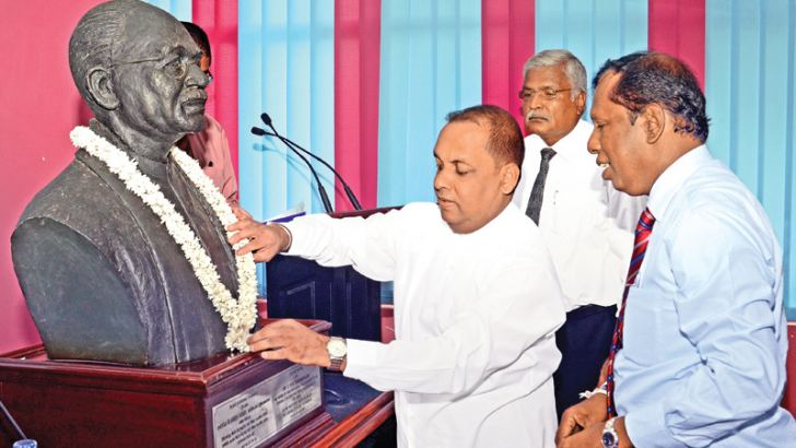 The picture shows Fisheries and Aquatic Resources Development Minister Mahinda Amaraweera garlanding the statue of 'Father of Free Education' late Dr. C. W. W. Kannagara at the Information Department auditorium. Pix. by Wimal Karunathilake