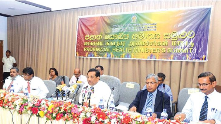 Health Minister Dr. Rajitha Senaratne and Health Ministry officials during the meeting.
