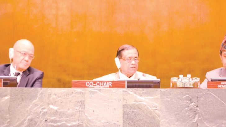 Ambassador Perera chairing the solemn event to mark the Day of Vesak at the United Nations General Assembly Hall. Permanent Representative of Thailand, Ambassador Virachai Plasai (L) and Vice President of the General Assembly and Permanent Representative of Nepal, Ambassador Durga Prasad Bhattarai (R) are also in the picture.