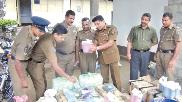 Police officers inspecting the seized stocks of blended weedicide