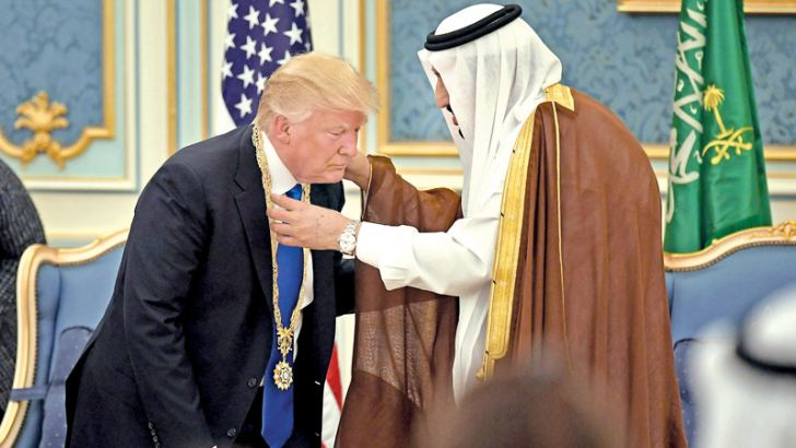 Saudi King Salman presents US President Donald Trump with The Collar of Abdulaziz Al Saud Medal at the Royal Court Palace- AFP