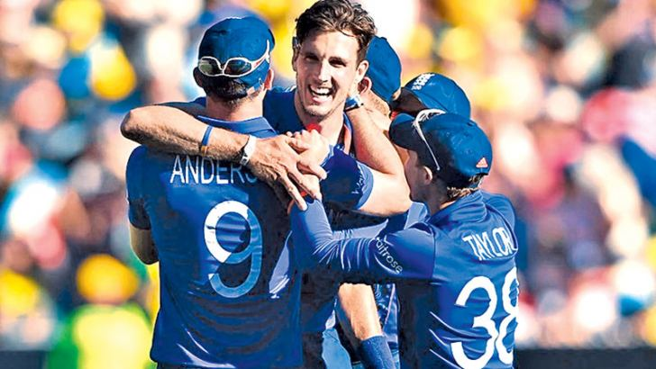 England fast bowler Steven Finn being congratulated after performing the hat-trick in a World Cup match against Australia at the MCG.