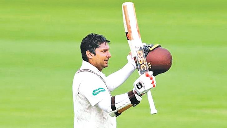 Kumar Sangakkara celebrates his second hundred for Surrey in their County Championship match against Middlesex at Lord's on Sunday.