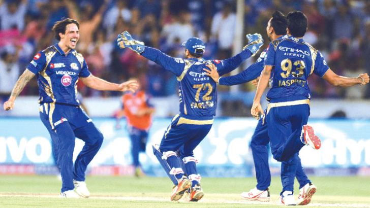 Mumbai Indians cricketers Parthiv Patel (C) and Mitchell Johnson (L) celebrate with teammates after their victory against Rising Pune Supergiant after the 2017 Indian Premier League (IPL) Twenty20 final cricket match between Mumbai Indians and Rising Pune Supergiant at The Rajiv Gandhi International Cricket Stadium in Hyderabad on May 21.