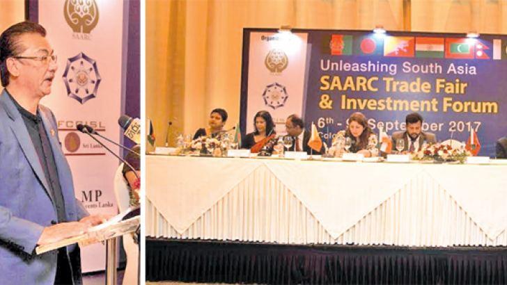 Suraj Vaidya, President of the SAARC Chamber of Commerce & Industry addressing the gathering. The distinguished members of the head table with Minister of Industry and Commerce, Rishad Bathiudeen
