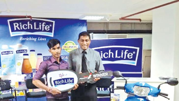 'Ride with Richlife' lucky winner Lahiru with Richlife COO Dinesh Nalliah