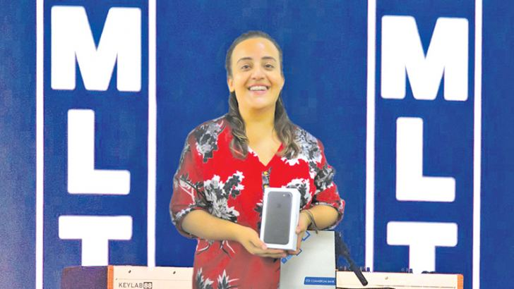 Laksheta Moorjani the winner of the business card draw with the iPhone 7 she won at the MLTR concert courtesy of Commercial Bank and World Mastercard.