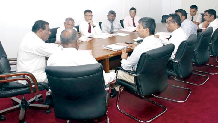Labour and Trade Union Relations Minister W.D.J.Seneviratne in conversation with GMOA officials.