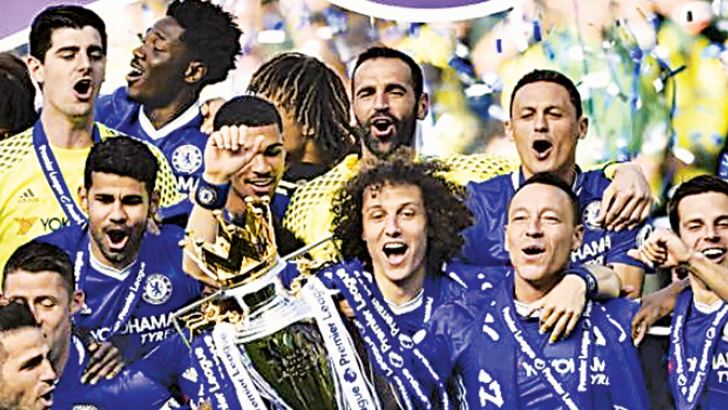 Chelsea celebrate with the trophy after winning the Premier League.
