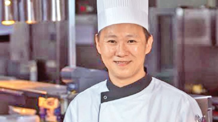 Chef Hanxi Yan with some of his new creations