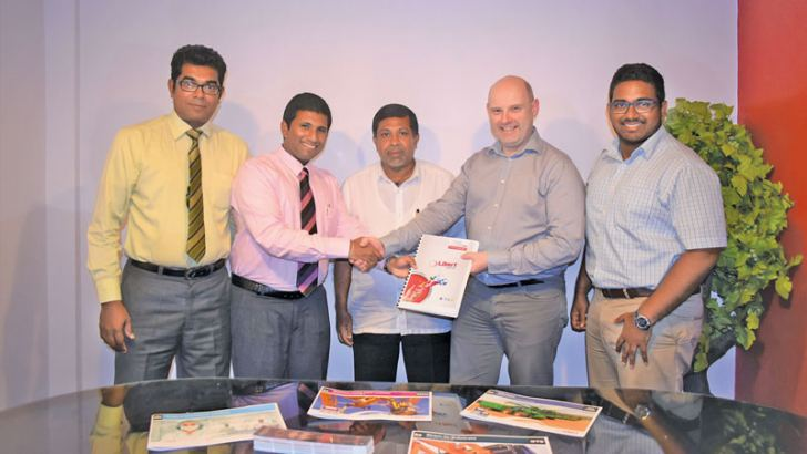 Harsha Ranasinghe Manager, Sushan Peiris Director,  Priyanath Peiris Managing Director, Perry Notenboom Business Development Manager, Libert Paints and Sharen Peiris Executive, ex changing the agreement.