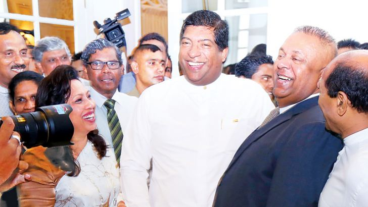 Finance and Media Minister Mangala Samaraweera  was at the Foreign Ministry to greet his successor Foreign Minister Ravi Karunanayake who assumed duties at the latter's Ministry.  Foreign Secretary Esala Weerakoon and family members of Minister Karunanayake were present.  Picture by  Chinthaka Kumarasinghe.