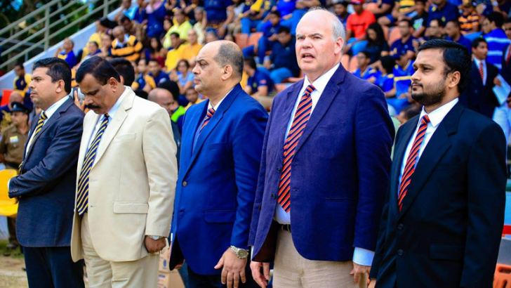 Tikiri Ellepola flanked by the two school principals Andrew Fowler-Watt of Trinity and B.A. Abeyaratne of Royal.  Shane de Silva POG Trinity and  M. A.M. Riyaz. Senior Sports Master Royal are also present.