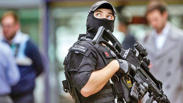 An armed police officer  at Manchester Piccadilly railway station.- AFP