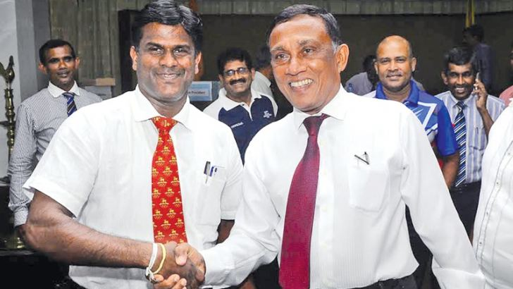 Outgoing president Sugath Tillakaratne (left) congratulates the newly elected president of the Athletic Association of Sri Lanka Palitha Fernando after the AGM held at the National Library and Documentation Services Board yesterday. Pic by Wasitha Patabendige