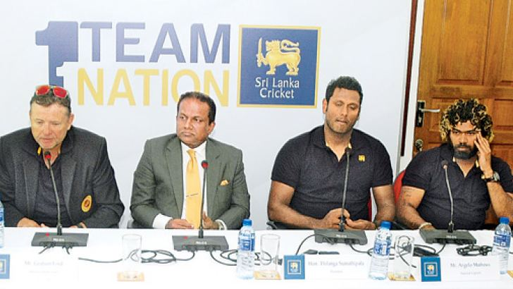 Sri Lanka captain Angelo Mathews and team mate Lasith Malinga with team officials and SLC president at the media conference yesterday.  Pic by Ranjith Asanka