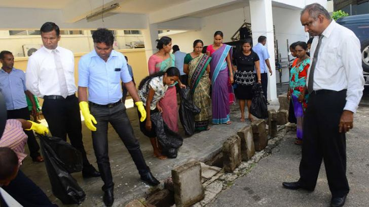 People throughout the country cleaned their surroundings from 9.30 am to 10.30 am yesterday on the instructions of the Health Ministry. They were asked to continue the practice every Friday, Health Ministry sources said. Here, Health Ministry officials cleaning the ministry premises.