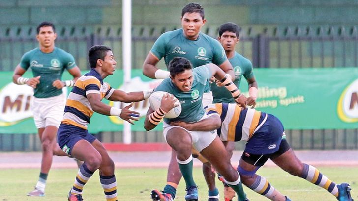 Isipathana winger Ramith Silva (Ball in hand) is tackled by Peterite number eight Angelo Mendis. Picture by Saman Sri Wedage