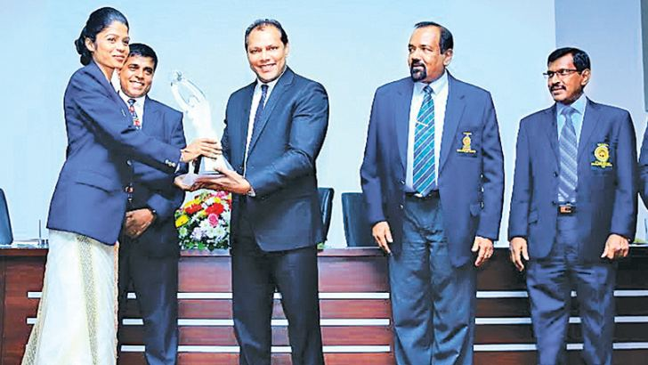Sports Minister Dayasiri Jayasekera handing over a certificate to a participant who had completed a sports diploma course. The Secretary of the Ministry Dr. R.M.B. Dissanayake and Director General of Sports Saman Bandara are also in the picture. Picture by Prince Gunasekara