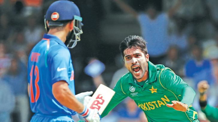 Pakistan fast bowler Mohammad Amir celebrates after taking the wicket of Indian captain Virat Kohli during the Champions trophy final at the Oval on Sunday.  AFP