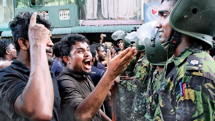 Inter University Students Federation (IUSF) members protesting in front of the Health Ministry demanding that the SAITM University be taken over by the government confronting the Police. Picture by Sudam Gunasinghe.