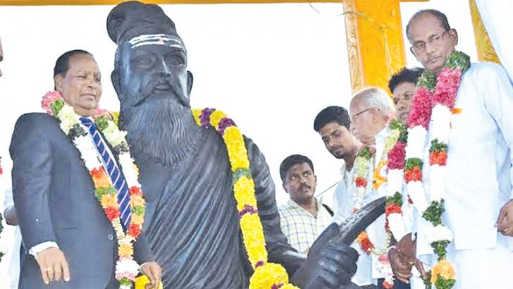 Dr. V.G.Santhosam and others beside the eight-foot Thiruvalluvar statue. Picture by Sivam Pakiyanathan, Batticaloa Special Corr.