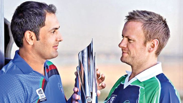 Afghanistan captain Mohammad Nabi and Ireland captain William Porterfield.